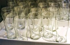 Collage of empty glasses isolated on white. Lots of empty glasses. Against the rack stock image