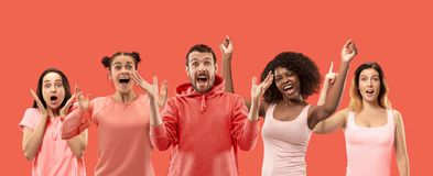The collage of faces of surprised people on coral backgrounds. Human emotions, facial expression concept. collage of men and women stock image