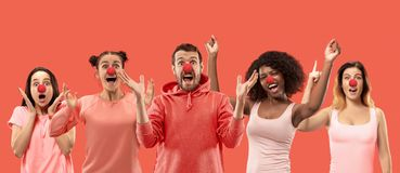The collage of faces of surprised people on coral backgrounds. royalty free stock photo