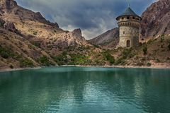 Wizard tower over the lake stock illustration