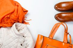 Flat lay set of  Feminine clothe  in autumn style. Collage of Feminine  clothing and accessories. jacket, boots, scarf, bag  for autumn day in yellow and orange Stock Photo
