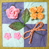 Collage of flowers on quilt. Artistic collage of different flowers on quilt Stock Photos