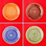 Collage från olika plattor på den röda bakgrunden Royaltyfri Bild