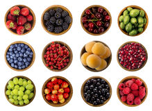 Collage of fruits and berries isolated on a white background. Top view. Collage of fruits and berries. Blueberries, blackberries, cherries, grapes, strawberries Royalty Free Stock Images