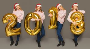 Collage of girl with 2018 number balloons portraits. Set of happy young woman with 2018 gold number balloons portraits. Smiling girl in santa hat positive Stock Photos