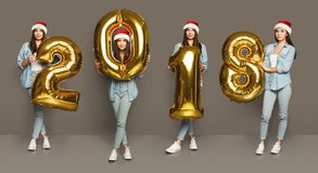 Collage of girl with 2018 number balloons portraits. Set of happy young woman with 2018 gold number balloons portraits. Smiling girl in santa hat positive Stock Photo
