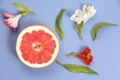 Collage of grapefruit and flowers Stock Photo