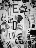 Collage of graphic letters and items. A black and white photo of cut out letters and items stock photos