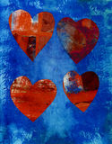 Collage Hearts. Four collaged mix media hearts on a blue painted background with space for text below Royalty Free Stock Photos