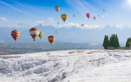 Collage with hot air ballons flying above snowy white Pamukkale in Turkey royalty free stock photos