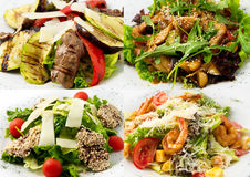 Collage hot salads their veal, beef, shrimp, chick Stock Images