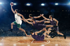The collage from images of one basketball player with a ball against the fans Stock Images