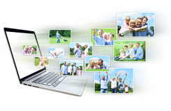 Collage of images out from laptop Royalty Free Stock Photo
