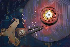 Collage, the imposition of the hard drive and the motherboard, c stock illustration