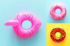 Collage of Inflatable rings over yellow and blue wooden background.  stock photo