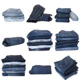 Collage of jeans isolated on white. Collection of folded jeans isolated on white background stock photo