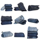 Collage of jeans isolated on white. Collection of folded jeans isolated on white background royalty free stock photos