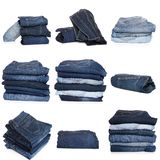 Collage of jeans isolated on white. Collection of folded jeans isolated on white background royalty free stock photo