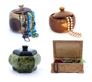 Collage of jewelery boxes with jewels isolated on white background royalty free stock photo