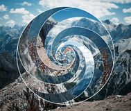 Collage with the landscape and the sacred geometry symbol spiral. Abstract mosaic collage with the image of the mountain landscape and the sacred geometry symbol royalty free stock photography