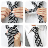 A man knotting his tie Stock Photos