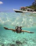 Collage med kvinnan som dyker till undervattens- Fotografering för Bildbyråer