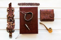 Collage men`s leather accessories on the background boards stock photos