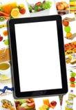 Collage met divers gezond voedsel en tablet Stock Afbeelding