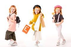 collage met zelfde jong geitje in verschillende kleren en met verschillende dingen Stock Afbeeldingen
