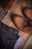 Collage of modern men's clothing on a brown  wooden background.  Royalty Free Stock Photos