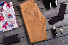 Collage of modern men's clothing. Collage of modern men's clothing on a dark wooden background Stock Images