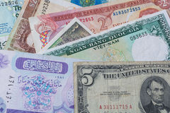 Collage of money or bank notes from different countries. Collage of foreign money or bank notes from countries like Vietnam, United States, old Saudi Arabia Stock Photos