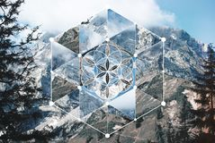 Collage with the mountain landscape and the sacred geometry symbol. Abstract background with the image of the mountain landscape and the sacred geometry symbol stock photography