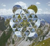 Collage with the mountains and the symbol flower of life. Abstract background with the image of the mountains and the flower of life. Sacred geometry. Harmony stock image
