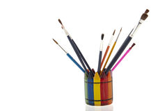 Collage of paintbrushes in a colourfull cup Royalty Free Stock Photography