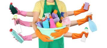Collage with people holding different cleaning supplies in hands. On white background stock photography
