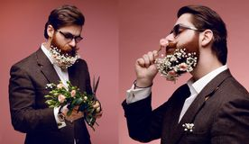 A collage with attractive bearded man in sunglasses and costume, with flowers in bearded, isolated on pink background. stock photography