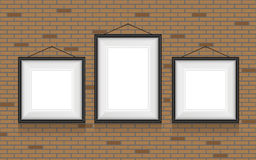 Collage of picture frames on the brick wall. Royalty Free Stock Image