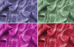 Collage of pink,purple,green and red checkered plaid clothes material. Close up macro view.Cloth background.Scottish pattern stock photo