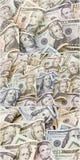 Collage plié par argent américain d'argent liquide de billets de banque d'isolement Images libres de droits