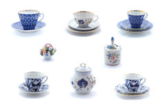 Collage of porcelain tea cups and dishes with flower ornament Royalty Free Stock Photography