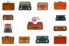 Collage of retro travel suitcases isolated on white. Set of old suitcases. Vintage baggage. Vintage travel bags. Pink flowers in jug on vintage suitcase. Pink Royalty Free Stock Image