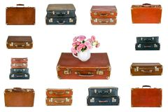 Collage of retro travel suitcases isolated on white. Set of old suitcases. Vintage baggage. Vintage travel bags. Pink flowers in jug on vintage suitcase. Pink Royalty Free Stock Photo
