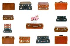 Collage of retro travel suitcases isolated on white. Set of old suitcases. Vintage baggage. Vintage travel bags. Pink flowers in jug on vintage suitcase. Pink Stock Photography
