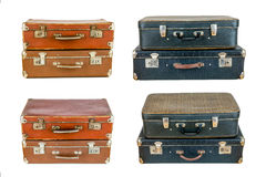 Collage of retro travel suitcases  on white. Set of old suitcases. Brown and black retro suitcase. Vintage baggage. Vintage travel bags Stock Photos