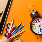 Collage with round clock, pencil and notebook, time concept. royalty free stock photos