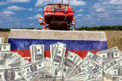 Collage Russian tractor cleans the U.S. dollar Russian land Stock Photo