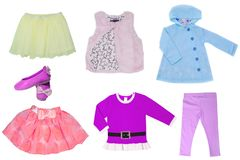 Collage set of little girl clothes for day of the child isolated on a white background. Colorful fashion for party or birthday stock photography