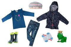 Collage set of little girl clothes isolated on a white background. The collection of a rain jacket, jeans , sweater, rubber boots stock photo