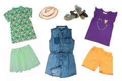 Collage set of little girl summer clothes isolated on a white background. The collection of a sleeveless jeans dress, shoes, short. Summer skirt, two shirts and stock images